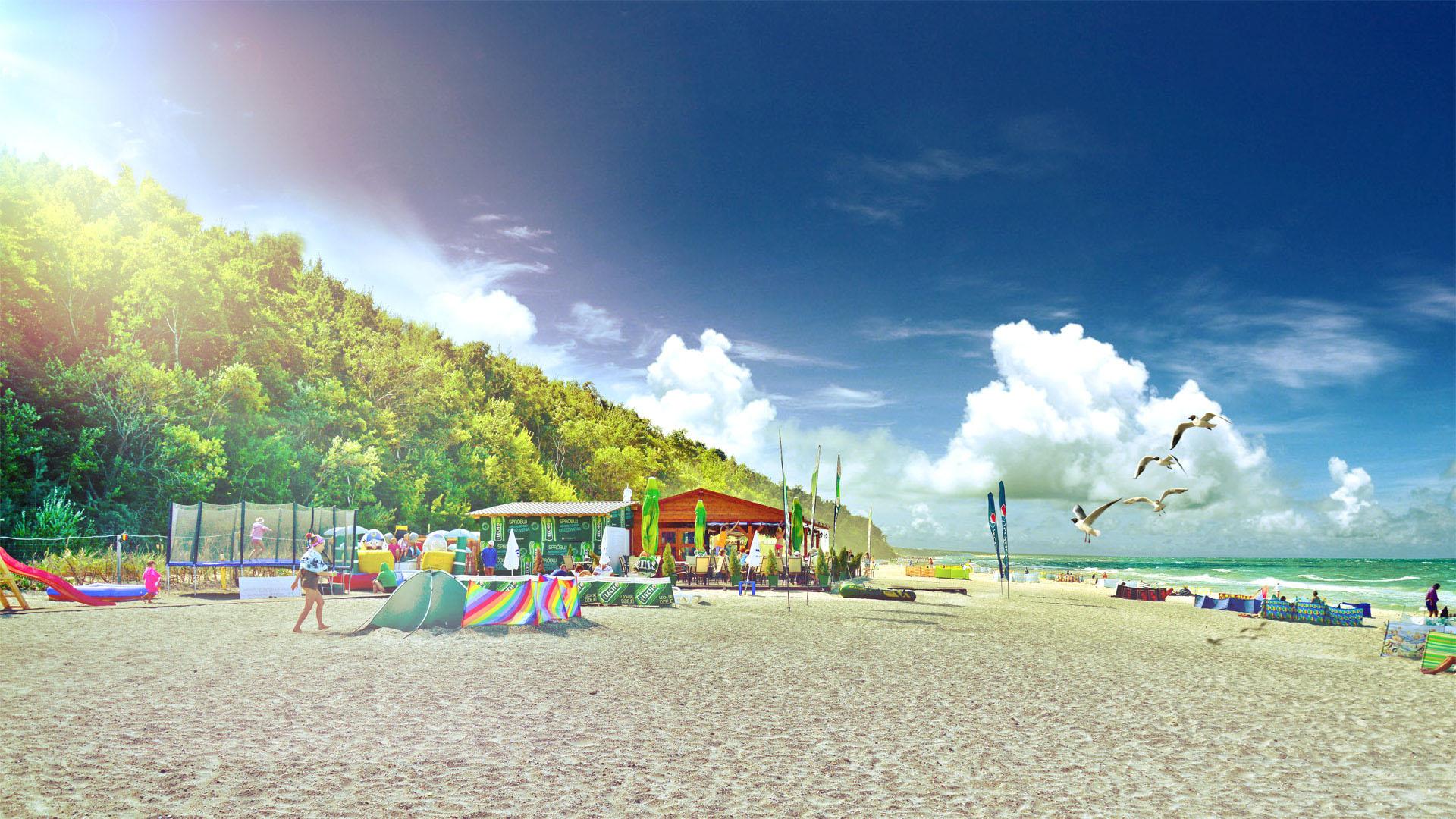 Słoneczny dzień, bar na plaży, z parawanami opalają się wczasowicze.